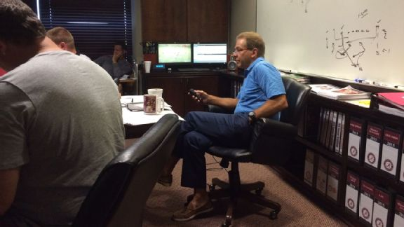 Nick Saban watching film